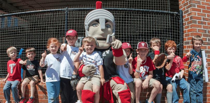 ten kids and a team mascot posing